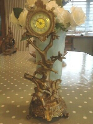 ANTIQUE  GILT BRONZE CHERUB / PUTTI MANTEL CLOCK 32 cm HIGH X 13 cm wide