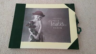 Anne Geddes 'Images' Visitors Album-HC with Green Ribbon Closure.