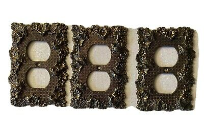 Vintage M.C. Co. Brass Raised Flowers Double Outlet Cover #3108 ca.1960's