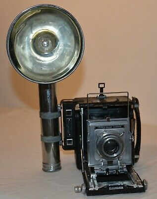 "TOWER press camera, 2 1/4"" x 3 1/4"", Kodak 101mm, flash with Graflex reflector"