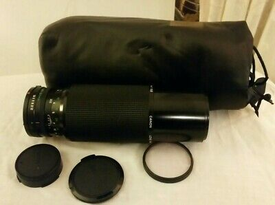 Canon 100-300mm 1:5.6 FD zoom lens with caps/Hoya skylight & soft case excellent