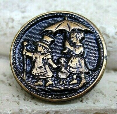 """Wonderful Antique Tinted Brass """"PLAYING GROWN UP"""" Button"""