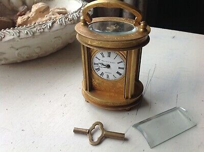 ELLIOTT & Son OVAL BRASS CARRIAGE CLOCK MADE IN ENGLAND WITH FRENCH ESCAPEMENT