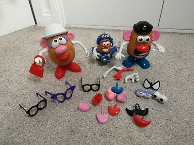 Mr and Mrs Potato head toys with accessories and baby potato in a plane