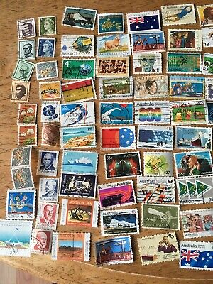 Mixed bag of 100 Australian stamps Various ages and themes Used.
