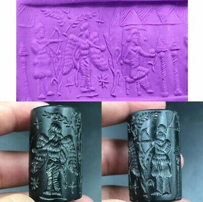 Near Eastern ancient black agate stone king with wings Stome cylinder seal bead