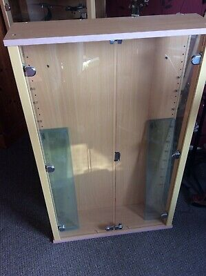 Display cabinet with glass shelves.