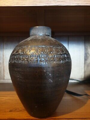 antique North African hand turned vase with hand pressed border