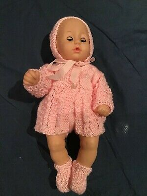 Hand knitted dolls clothes for 14 inch doll.