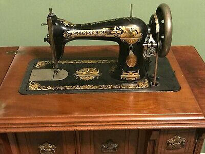 Singer sewing machine in walnut parlor cabinet