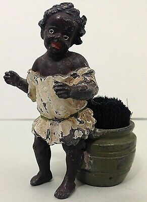 Antique cast metal pin cushion figurine of African girl with barrel