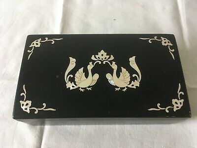Black Lacquered box with inlaid mother of pearl exotic birds.