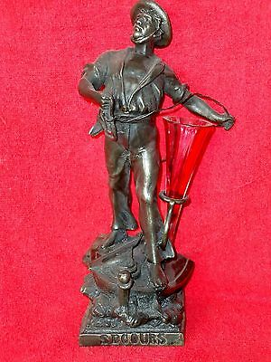 "Antique spelter ""Secours"" figure"