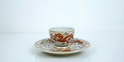 A Rare Set of Iron-Red-Decorated 'Dragon' Cup and Saucer