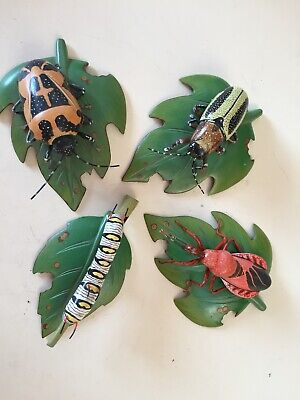 Wooden hand carved and hand painted bugs