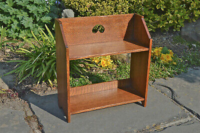 Arts and Crafts small oak book shelf rack with stylised cut out circa.1910