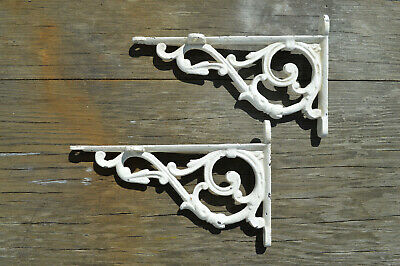Pair of antique cast iron shelf brackets no reserve price