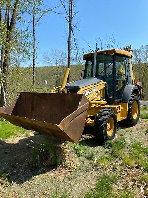 John Deere 310 SG Backhoe with Skid Loader, 3 Buckets & Thumb attachments