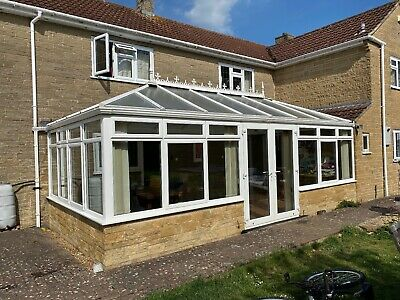 Fabulous UPVC CONSERVATORY including chandelier lights, fans & french doors.