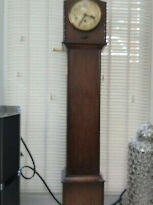 oak grandmother clock with  key  good  condition