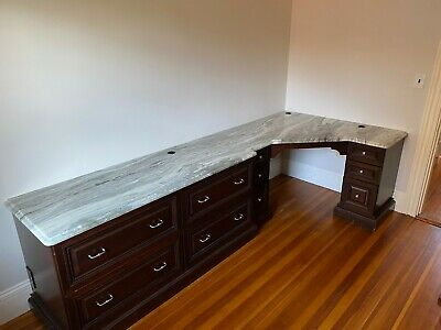 Marble top Wood desk 4 large drawers, 8 small. Matching wood cabinet.