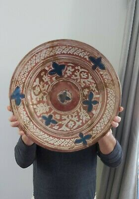 A rare large Hispano Moresque ceramic plate first half 17th century.16inch diame