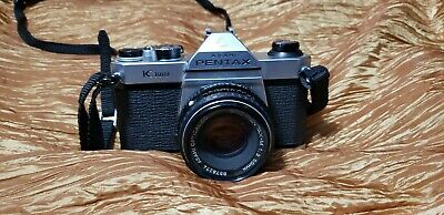 Pentax K1000 35mm SLR Film Camera with 50 mm lens and Pentax AF160 flash