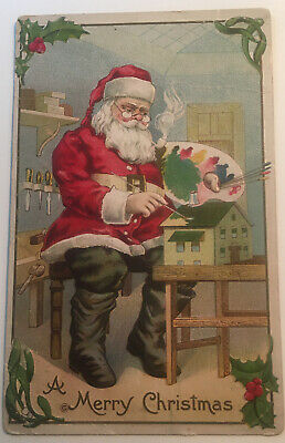 Antique Merry Christmas Postcard Santa w/Pipe in Workshop Painting Toy House