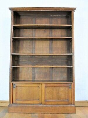Antique oak tall open bookcase with cupboard