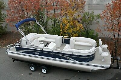 Scratch and dent New 25 ft bow Fish with 115 hp and  bunk trailer.