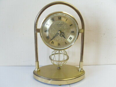 Wm Widdop Mantel Quartz Clock - round gold coloured with skeleton ball