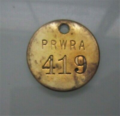 P R W R A (Puerto Rico Water Resources Authority) worker tag.