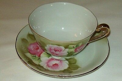 BEAUTIFUL LEFTON HAND PAINTED CUP AND SAUCER WITH SILVER LOGO & STICKER