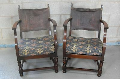 Pair of oak framed fireside chairs with studded leather backs and cushions
