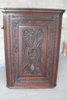 19th century carved oak corner cabinet