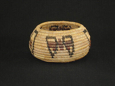 A Mono Paiute Yosemite polychrome butterfly American Indian basket, circa 1920