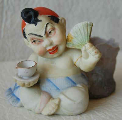 21. NOVELTY MADE IN JAPAN CHUBBY JAPANESE MAN WITH FAN & TEA CUP TOOTHPICK HOLDR