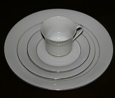 THE CELLAR FOUR PIECE PORCELAIN PLACE SETTING OF CLASSIC ELEGANCE PATTERN