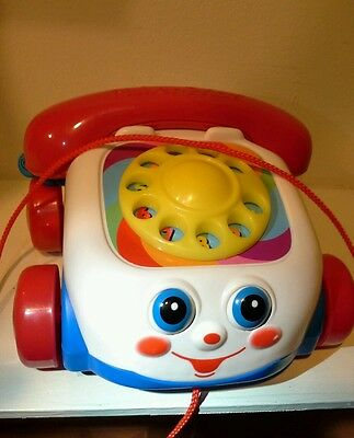 2000 chatter telephone Fisher price eyes roll pull along read