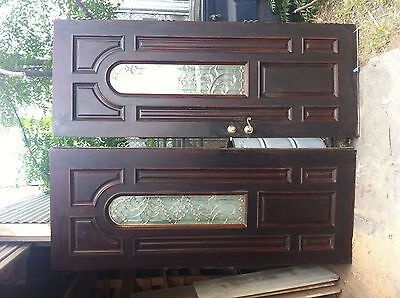 Double doors w/ applied moldings, inlaid panels, glass panels with bronzework