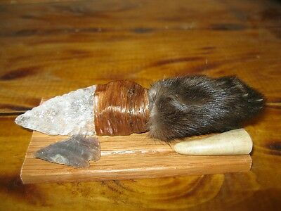 0125...  KNIFE WITH A PINE MARTEN PAW HANDLE AND A CRYSTAL QUARTZ BLADE