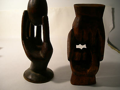 Two African Wood Carvings - Hand Holding an Egg & Clasped or Interlocking Hands