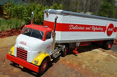 VINTAGE 18YR COCA COLA SODA DRINK WITH BUTTON SIGNMETAL TRUCK SUPER MINT IN BOX