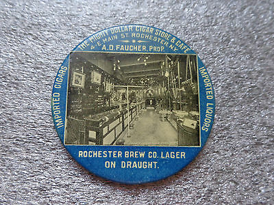 old Celluloid pocket mirror advertising The Mighty Dollar Cigar Store & Cafe