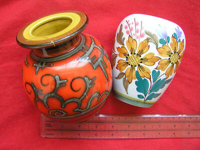 Two Gouda hand painted vases.