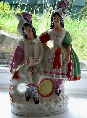 DECORATIVE STAFFORDSHIRE FIGURE WITH DOG