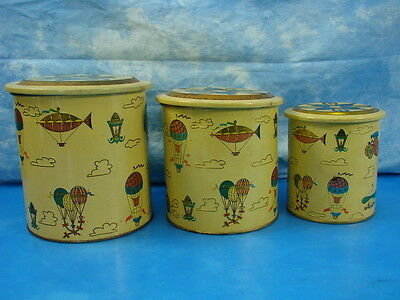 Set of 3 Vintage Yellow Gold Tin Canisters Stacking Parachutes Cars Planes
