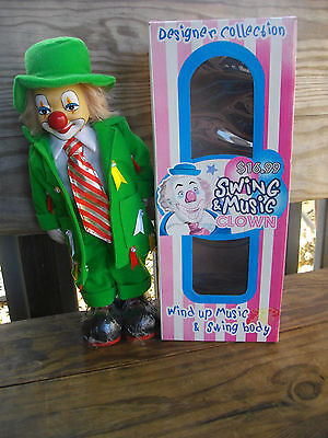 Vintage Clown Doll,Wind Up Music & Swing Body Green Suit 13'' Porcelain in Box