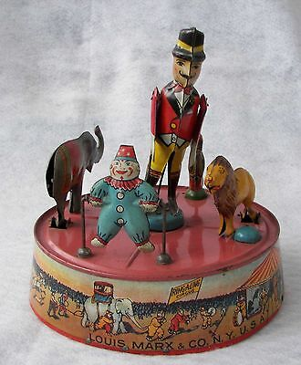 Vintage Marx Ring-A–Ling Circus tin wind-up with pink base, circa 1925
