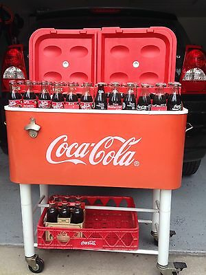 80 Quart Rolling  Coca Cola Cooler with 180 Collectiable Coke Bottles